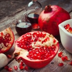 Pomegranate and bottles of essence or tincture